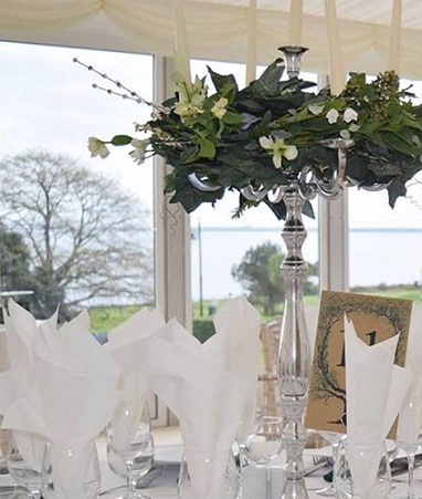 A Centerpiece, Candelabra Silver with floral ring to hire x 10